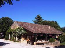 Barn bar-lounge of Domaine de Gavaudun cottages resort and holiday park in Dordogne Lot