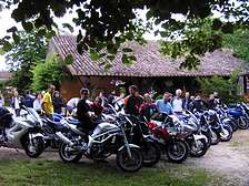 Groups hiking motorbikes rally at gites holiday resort in Dordogne Lot Gavaudun